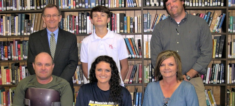 Blake Martin (center, seated) signed with BMC women's basketball
