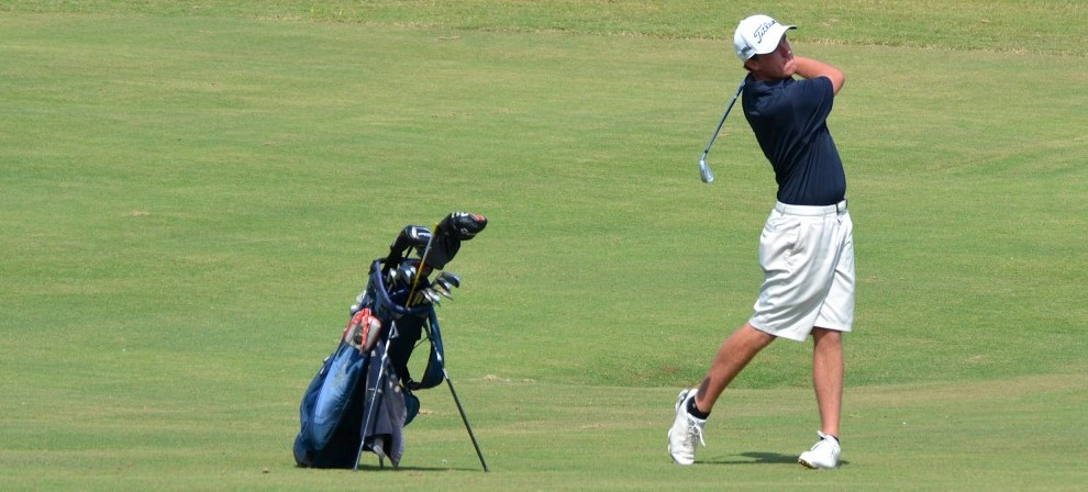 Clint Phillips hits an approach shot at TPC Louisiana on Monday