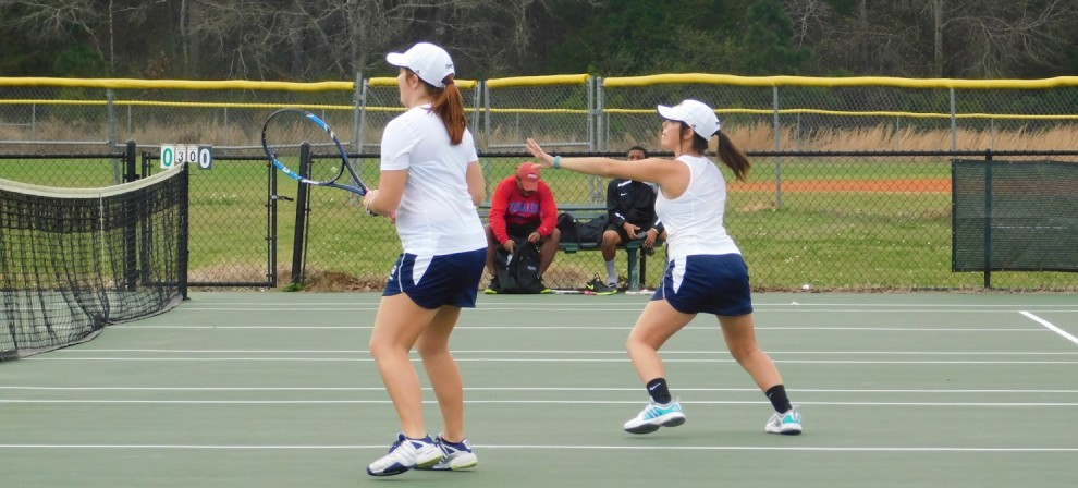 Olivia Dunnam (left) and Attie Finley in doubles action