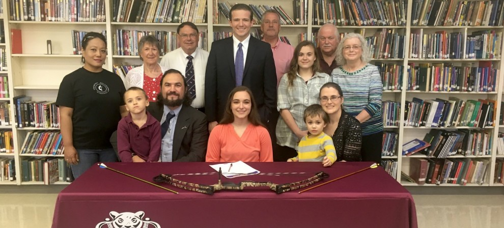 Elizabeth Stokes (seated, center) signed with BMC Archery