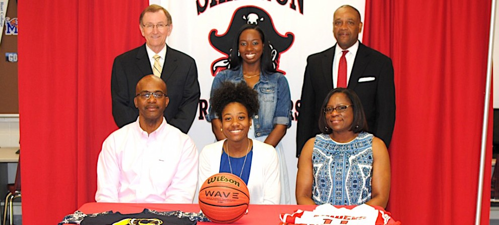 Jermiyah Smith (center, seated) signed with BMC women's basketball