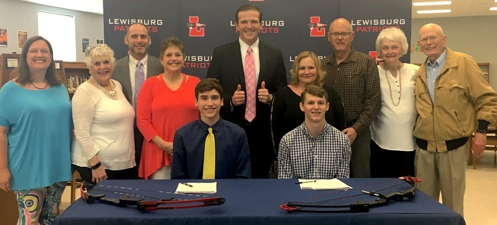 Davis Ruffin (seated, left) and Trey Paris (seated, right) signed with BMC Archery