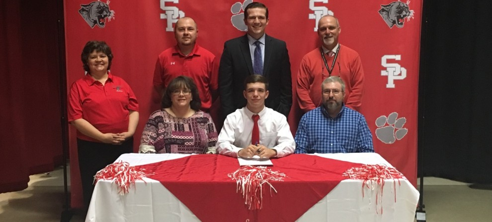 Tanner Huffman (seated, center) signed with BMC Archery