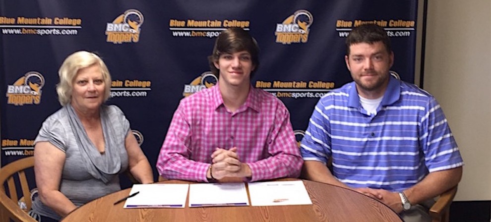 Taylor Grantham (center) signed with Blue Mountain College Bowling Friday.