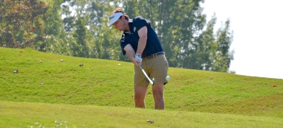 Owen Patterson hits from a par three hole Thursday